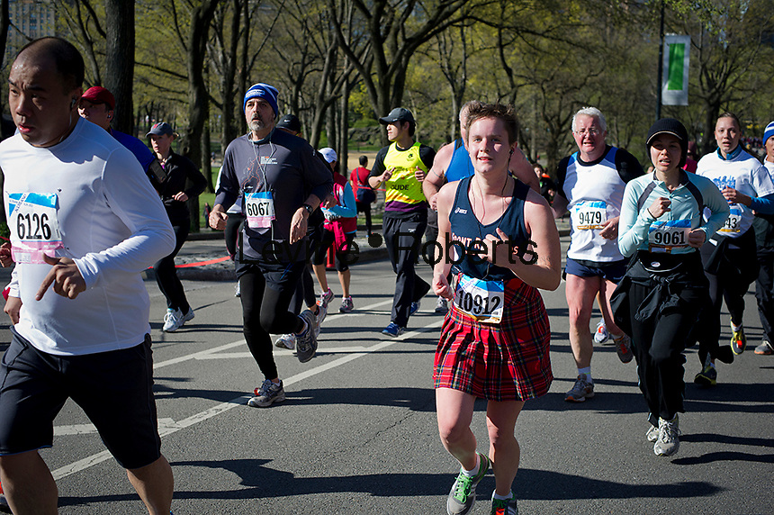 Over 10,000 runners race around Central Park in New York on Saturday, April 7, 2012 for the 10K Scotland Run, the beginning of Tartan Week. The holiday celebrates Americans of Scottish descent and many of the runners wore tartan kilts, face paint in the national colors of Scotland, blue and white, or just decorated themselves with themed costumes. (© Frances M. Roberts)