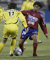 08 November 2006: CSD Municipal's Sergio Guevara, right, tries to kick the ball past Columbus Crew's Ned Grabavoy during the first half in Columbus, Ohio.<br />