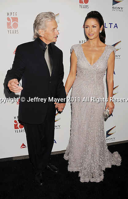 "CULVER CITY, CA - OCTOBER 15: Michael Douglas and Catherine Zeta-Jones attend the The 6th Annual ""A Fine Romance"" Event at Sony Pictures Studios on October 15, 2011 in Culver City, California."