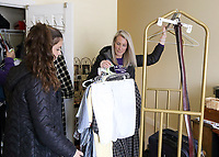 (L-R) Audrey Smith and Emma Keller help move a resident's clothes at Magnolia Springs Bridgewater, an assisted living community in Carmel.