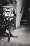 a private sign stands at the bottom of a stair case in a courtyard at Christ College, Cambridge