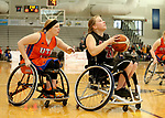 MARSHALL, MN - MARCH 17:  Selina Rousch #21 from Alabama drives to the basket past Morgan Wood #10 from the University of Texas Arlington during their championship game at the 2018 National Intercollegiate Wheelchair Basketball Tournament at Southwest Minnesota State University in Marshall, MN. (Photo by Dave Eggen/Inertia)