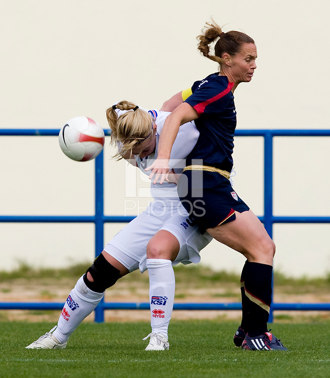 Christie Rampone, Margret Lara Vidarsdottir.  The USWNT defeated Iceland, 1-0, at Ferreiras, Portugal.