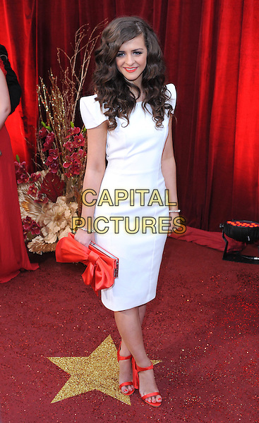 REBECCA RYAN.The British Soap Awards 2010, London Television Centre, London, England..8th May 2010.arrivals full length white dress shoulder pads red clutch bag open toe sandals .CAP/BEL.©Tom Belcher/Capital Pictures.