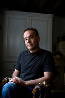 Nick Broomfield, documentary film maker, photographed in his home in Sussex.