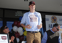 NWA Democrat-Gazette/ANDY SHUPE<br /> Antonio Thomas (center) of Haas Hall Academy, a swimmer for the Razorback Aquatic Club AquaHawgs swim team, shows off his Missouri State T-shirt Thursday, Nov. 12, 2015,  after signing a letter of intent to swim for the Bears during a ceremony at the school. Beside him are his mother, Stephanie, and father, Aaron.