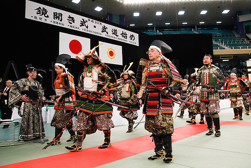 10.01.2011 Tokyo, Japan - A band of armor-clad samurai warriors pump up a traditional Kagami-biraki ceremony to kick off new years first martial arts training at Tokyos Budokan Martial Arts Hall. The tradition of Kagami-biraki was originated in 15th century among samurais to officially start the first workout of the new year.