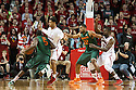December 4, 2013: Shavon Shields (31) of the Nebraska Cornhuskers defending against Davon Reed (5) of the Miami (Fl) Hurricanes while Leslee Smith (21) of the Nebraska Cornhuskers is guarding Donnavan Kirk (22) of the Miami (Fl) Hurricanes at the Pinnacle Bank Areana, Lincoln, NE. Nebraska defeated Miami 60 to 49.