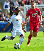 Pictured: Swansea's Wayne Routledge (L) making a pass.<br /> Saturday 20 April 2013<br /> Re: Barclay's Premier League, Swansea City FC v Southampton at the Liberty Stadium, south Wales.