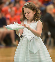NWA Democrat-Gazette/ANTHONY REYES &bull; @NWATONYR<br /> Alison Pattyson tries to steady the junior princess crown Friday, Sept. 25, 2015 at the Rogers Heritage Homecoming rally at the school in Rogers. The event including the introduction of the 2015 homecoming court, musical performances, dancing and a pep rally for a football game against Springdale.