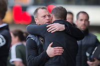 Newport County manager Michael Flynn greets Notts County manager Kevin Nolan during the Sky Bet League 2 match between Newport County and Notts County at Rodney Parade, Newport, Wales on 6 May 2017. Photo by Mark  Hawkins / PRiME Media Images.