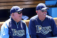 Tampa Bay Rays coach Don Zimmer #64 (left) talking with another coach before a spring training game against the Baltimore Orioles at the Charlotte County Sports Park on March 5, 2012 in Port Charlotte, Florida.  (Mike Janes/Four Seam Images)