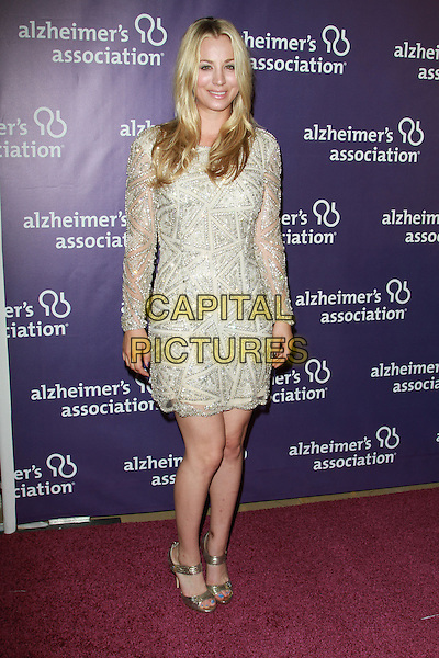 "KALEY CUOCO.19th Annual ""A Night at Sardi's"" Benefiting the Alzheimer's Association held at the Beverly Hilton Hotel, Beverly Hills, California, USA, 16th March 2011..full length dress gold beaded jewel encrusted sparkly open toe shoes .CAP/ADM/KB.©Kevan Brooks/AdMedia/Capital Pictures."
