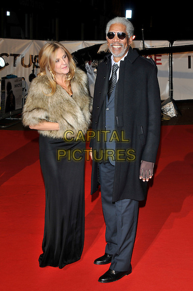 "LORI McCREARY & MORGAN FREEMAN .Attending the ""Invictus'"" UK Film Premiere at the Odeon West End cinema, Leicester Square, London, England, January 31st, 2010..arrivals full length sunglasses aviators black tie grey gray suit coat beige brown fur jacket long maxi dress hands in pockets .CAP/PL.©Phil Loftus/Capital Pictures"