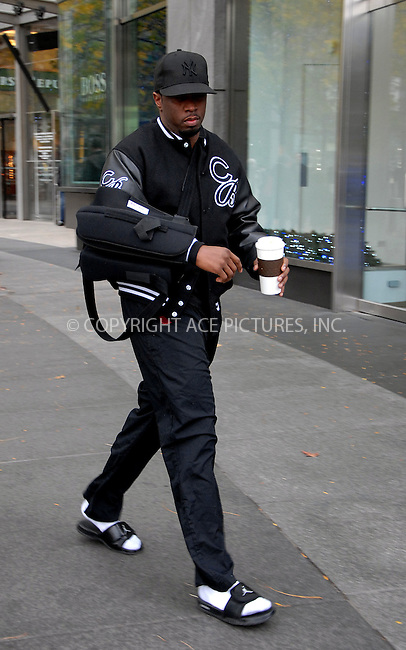WWW.ACEPIXS.COM . . . . .  ....November 21 2011, New York City....Rapper Puffy Daddy has him arm in a sling walking on the Upper West Side on November 21 2011 in New York City....Please byline: CURTIS MEANS - ACE PICTURES.... *** ***..Ace Pictures, Inc:  ..Philip Vaughan (212) 243-8787 or (646) 679 0430..e-mail: info@acepixs.com..web: http://www.acepixs.com