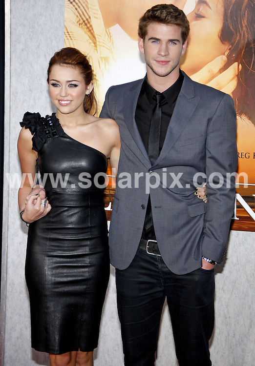 **ALL ROUND PICTURES FROM SOLARPIX.COM**.**SYNDICATION RIGHTS FOR UK, AUSTRALIA, DENMARK, PORTUGAL, S. AFRICA, SPAIN & DUBAI.The Last Song, World Premiere - Arrivals, ArcLight Hollywood Cinema, CA, USA, 25 March 2010.This pic: Miley Cyrus and Liam Hemsworth.JOB REF: 10979    PHZ ortega DATE: 25_03_2010.**MUST CREDIT SOLARPIX.COM OR DOUBLE FEE WILL BE CHARGED**.**MUST NOTIFY SOLARPIX OF ONLINE USAGE**.**CALL US ON: +34 952 811 768 or LOW RATE FROM UK 0844 617 7637**