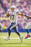 21 September 2014: San Diego Chargers quarterback Philip Rivers scrambles in the backfield during a game against the Buffalo Bills at Ralph Wilson Stadium in Orchard Park, NY. The Chargers defeated the Bills 22-10 in AFC play. Mandatory Credit: Ed Wolfstein Photo *** RAW (NEF) Image File Available ***