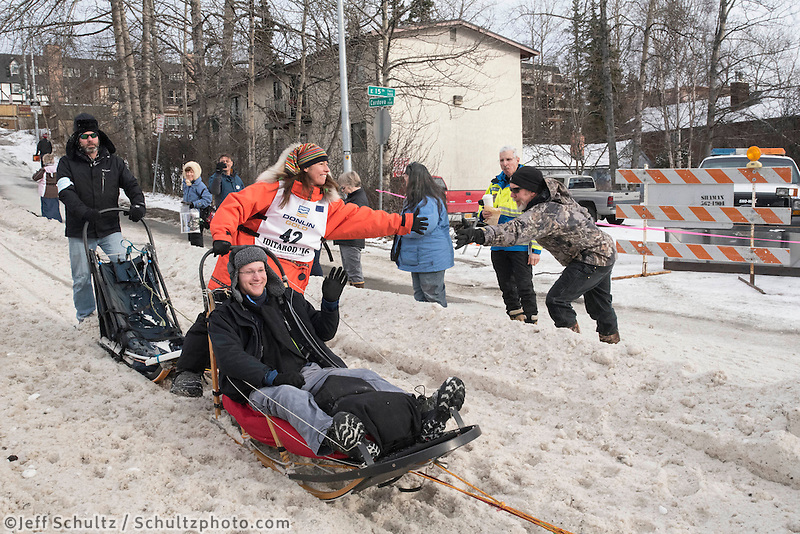 Kristin Bacon and team run past spectators on the bike/ski trail with an Iditarider in the basket during the Anchorage, Alaska ceremonial start on Saturday, March 5, 2016 Iditarod Race. Photo by O'Hara Shipe/SchultzPhoto.com