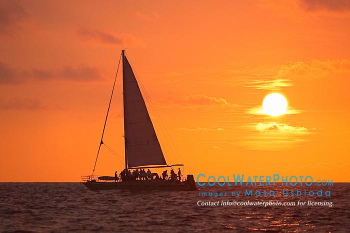 Sailboat at sunset, off Kona Coast, Big Island, Hawaii, Pacific Ocean