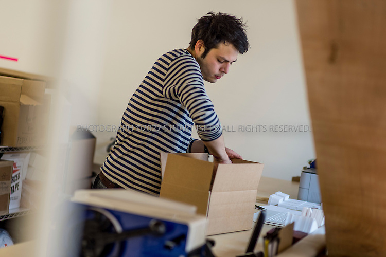 6/7/2012--Seattle, WA,USA..Totokaelo main store in the Capitol Hill neighborhood in Seattle, WASH...Here Carlos Ruize, 25, packs online orders for shipping to customers...©2012 Stuart Isett. All rights reserved.