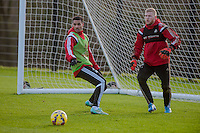 SWANSEA, WALES - JANUARY 28:  Kyle Naughton of Swansea City  and David Cornell of Swansea City wait for the ball during training  on January 28, 2015 in Swansea, Wales.