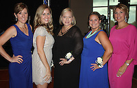 NWA Democrat-Gazette/CARIN SCHOPPMEYER Meredith Wiktorowki (from left), Nevada Efird, Amy Combs, Heather Foitek and Andrea Morris, Fincher Foundation board members, welcome guests to a Cool Summer Homecoming.