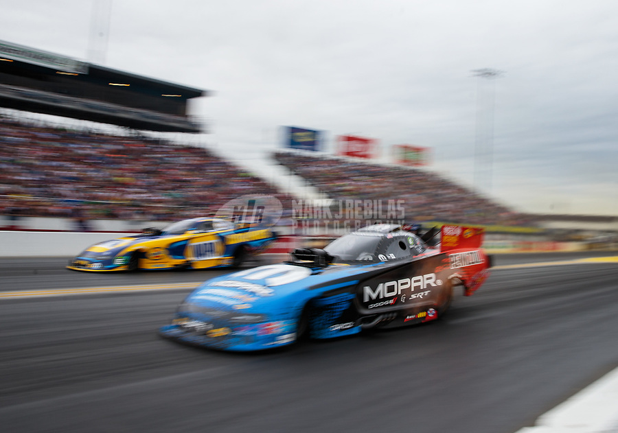 Mar 16, 2019; Gainesville, FL, USA; NHRA funny car driver Matt Hagan (near) races alongside Ron Capps during qualifying for the Gatornationals at Gainesville Raceway. Mandatory Credit: Mark J. Rebilas-USA TODAY Sports