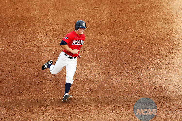 24 JUNE 2012:  Johnny Field (1) of the University of Arizona races to third base against the University of South Carolina during the Division I Men's Baseball Championship held at TD Ameritrade Park in Omaha, NE.  Arizona defeated South Carolina 5-1 in the first game.  Jamie Schwaberow/NCAA Photos