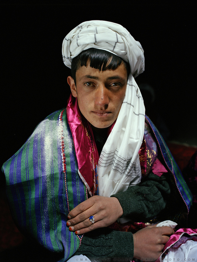 Portrait of Dodé Khuda. Flour has been thrown on his coat, a Wakhi tradition, for the couple prosperity. Wedding celebration of Dodé Khuda, at Safar Boi house, in Tchehel-Kand village..Wakhi wedding ceremonies usually takes place in the winter months. The Wakhi do most of their business with Afghan Kyrgyz..Winter expedition through the Wakhan Corridor and into the Afghan Pamir mountains, to document the life of the Afghan Kyrgyz tribe. January/February 2008. Afghanistan