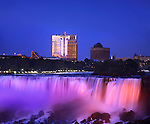 Colorful Spotlights Paint The American Falls At Night, Niagara Falls New York Seen From Ontario Canada
