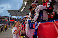 CARSON, CA - FEBRUARY 9: Lindsey Horan #9 of the United States signs autographs during a game between Canada and USWNT at Dignity Health Sports Park on February 9, 2020 in Carson, California.