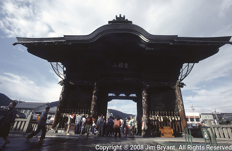 More than 8 million people pass through the 45-foot-tall Nioman gate as they make a yearly  pilgirmage to Nagano, Japan to the Zenkoji Temple, the mecca of Buddhism.  The towering two-tiered, thatched-roof  temple that was build in 624 AD, was designed in 1707 a national treasure.   (Jim Bryant Photo).....