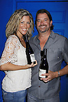 "General Hospital Laura Wright ""Carly"" poses with her husband John Wright and hold Standing Sun Wines at a Wine Tasting for Standing Sun Wines on August 11, 2012 at MaGooby's Joke House in Timonium, Maryland. The fans got a chance to takes all the various wines, a Q&A, photos, autographs. L(Photo by Sue Coflin/Max Photos)"
