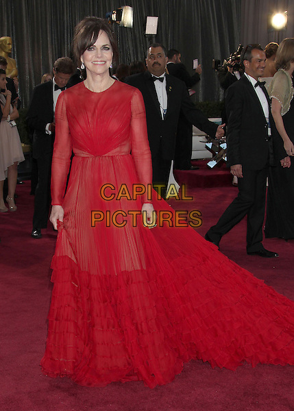 Sally Field (wearing Valentino).85th Annual Academy Awards held at the Dolby Theatre at Hollywood & Highland Center, Hollywood, California, USA..February 24th, 2013.oscars full length red sheer frills train dress long sleeves .CAP/ADM/RE.©Russ Elliot/AdMedia/Capital Pictures.