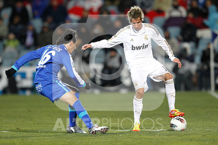 Getafe's Pedro Rios and Real Madrid's Fabio Coentrao during la Liga match on February 4th 2012. ..Photo: Cesar Cebolla / ALFAQUI