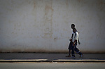 Two immigrants are walking near to Temporary Centre for Immigrants - CETI -  in Melilla, a Spanish city separated from the rest of Africa by a fence permanently guarded.