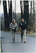 Thurmont, MD - November 6, 1986 -- United States President Ronald Reagan walks with British Prime Minister Margaret Thatcher at Camp David near Thurmont, Maryland on November 6, 1986..
