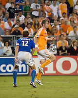 Houston Dynamo forward Nate Jaqua (21) settles the ball as Kansas City Wizards defender Jimmy Conrad looks (12) on.  The Houston Dynamo defeated the Kansas City Wizards 2-0 at Robertson Stadium in Houston, TX on November 10, 2007 to capture the MLS Western Conference Championship. The Houston Dynamo will take on the New England Revolution in the MLS Cup Final on November 18, 2007 at RFK Stadium in Washington D.C.