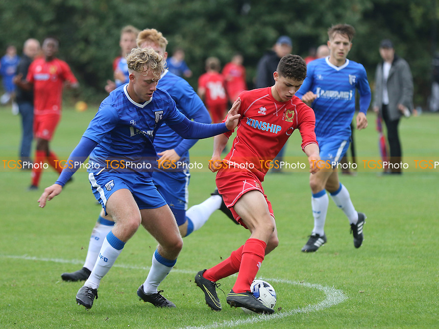 Joe Evans of MK Dons shields the ball from his opponent during Gillingham Under-18 vs Milton Keynes Dons Under-18, EFL Youth Alliance Football at Beechings Cross, Gillingham FC Training Ground on 8th October 2016