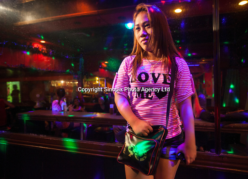 A prostitute in the Rio Bar, the Angeles City 'girly bar' that British banker Rurik Jutting used to frequent, is seen after sharing her experiences of the alleged murderer, Angeles City, Republic of the Philippines, 08 November 2014. The 'sin city', which sprung up on the fringes of a US Air Force base during the Vietnam war, has a reputation for cheap sex, and was a favourite destination for alleged murderer Rurik Jutting, who used to fly to Angeles City from Hong Kong for debauched weekends. The British banker is currently on remand at a secure facility in Hong Kong for allegedly murdering two Indonesian prostitutes in his flat whilst high on alcohol and cocaine.