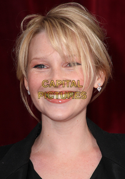JOANNA PAGE.'An Audience with Michael Buble' at the London ITV Studios, South Bank, London, England..May 3rd, 2010.headshot portrait black smiling messy hair windy .CAP/JIL.©Jill Mayhew/Capital Pictures.