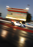 Jan 25, 2009; Chandler, AZ, USA; NHRA funny car driver Mike Neff races down track during testing at the National Time Trials at Firebird International Raceway. Mandatory Credit: Mark J. Rebilas-