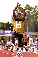 With teammate Jeremy Lampley watching from behind, Missouri freshman Jonathon Ilor flies toward the sandpit in the triple jump at the Big 12 Outdoor Track and Field Championships in Manhattan, Ks. Sunday. Ilori jumped a personal best of 51-1 to earn a runner-up finish and move into 5th on the Missouri all-time performance list.