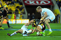 Aaron Cruden and Matt Proctor tussle during the Super Rugby semifinal match between the Hurricanes and Chiefs at Westpac Stadium, Wellington, New Zealand on Saturday, 30 July 2016. Photo: Dave Lintott / lintottphoto.co.nz