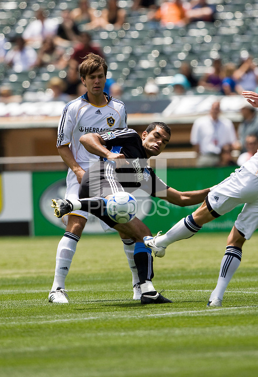 June 20, 2009:  Pablo Campos of Earthquakes and Stefani Miglioranzi  of Galaxy fight for the ball during a game at Coliseum in Oakland, California. San Jose Earthquakes defeated Los Angeles, 2-1.