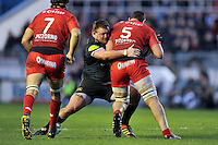 David Wilson of Bath Rugby tackles Konstantin Mikautadze of Toulon. European Rugby Champions Cup match, between RC Toulon and Bath Rugby on January 10, 2016 at the Stade Mayol in Toulon, France. Photo by: Patrick Khachfe / Onside Images
