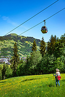 Austria, Tyrol, Westendorf (Tyrol): Hiking Village at Brixen Valley with parish church St Nicolas, Alpenrose cable car and Hohe Salve mountain | Oesterreich, Tirol, Westendorf (Tirol): Wanderdorf im Brixental mit Pfarrkirche St. Nikolaus, Kabine der Alpenrosenbahn und Gipfel Hohe Salve