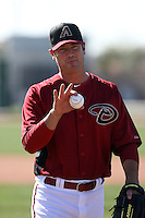"Josh Booty, winner of MLB Networks' reality show ""The Next Knuckler,"" works out with the Arizona Diamondbacks during spring training at Salt River Fields on February 23, 2013 in Scottsdale, Arizona (Bill Mitchell)"