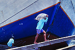 Loading a Phinisi boat in Jakarta docks, Indonesia.