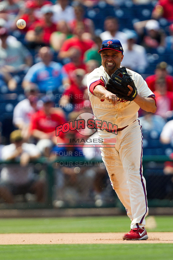 Philadelphia Phillies third baseman Placido Polanco #27 throws to first during the Major League Baseball game against the Pittsburgh Pirates on June 28, 2012 at Citizens Bank Park in Philadelphia, Pennsylvania. The Pirates defeated the Phillies 5-4. (Andrew Woolley/Four Seam Images).